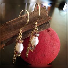 A personal favorite from my Etsy shop https://www.etsy.com/listing/462030718/pearl-and-amber-crystal-with-gold