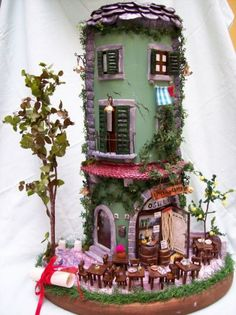 """""""The Inn"""", hand-shaped and hand-painted item using self-curing dough etc. Carefully finished, the body of the item is a half-round tile, the base is made of wood"""