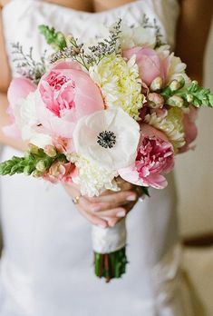 A bouquet of pink peonies, white anemones, and mums | Brides.com