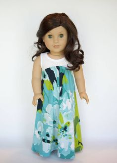 This listing is for one maxi dress, made to fit the American Girl Dolls and similar 18 inch dolls  This maxi dress is simply stunning! The dress is made from a white, knit fabric on top, and a blue and green floral print knit fabric on the bottom. There is a velcro closure at the top back. All inside seams and edges are serged for a professional look.  The fabric was pre-washed and sewn in my smoke-free home. A modified Liberty Jane pattern was used.  Doll, and necklace not included. Take…