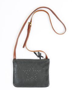 Butter soft leather shoulder bag with a punched star design. Veg tan leather adjustable strap. Zip fastening with a bone toggle. Every bag has a silver inner pocket for that little extra sparkle !Available in other colours Bag Approx 20 x 18cmStrape length approx 120cm