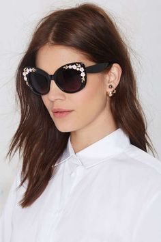 Cat-eye shades with gold and pink floral detailing at sides ==