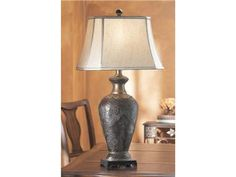 Shop for Midwest - CBK Table Lamp, 21253, and other Lamps and Lighting at Cherry House Furniture in LaGrange, KY. Table Lamp with Footed Base and Tapered Cone-Shaped Stem with Embossed Pattern, Dark Bronze and Old Gold finish and Rectangle-Cut corner Shade.