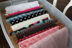 Wrap your fabrics around sheets of cardboard and stand them up in a tote.