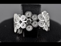 """""""Daisy"""" ring by Olmox Jewelry, detailed design of daisies make up this beautiful and elegant band, handmade sterling silver filigree www.olmox.com"""