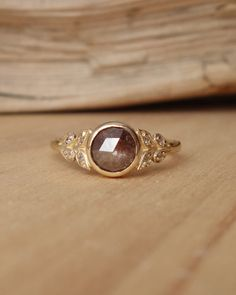 This new selection of rose cut diamonds have life and sparkle with large or smaller cut facets in soothing earthy tones. Each one is unique and has