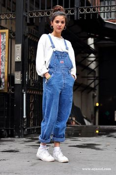 Glastonbury Festival Fashion Inspiration. hippie, bohemian, boho. Blue denim jean dungarees, 90s, hoop earings, retro trainers, bun hair style More