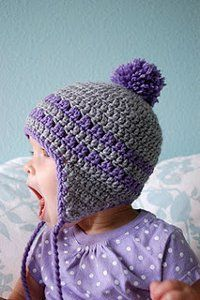 This Purple and Gray Earflap Hat is adorable! The pattern is made for babies nine to 12 months, but provides instructions for other sizes as well. The pom on the top is the perfect embellishment for this baby crochet hat pattern.