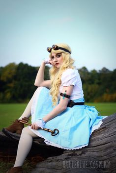 Steampunk Alice in Wonderland Cosplay (white blouse, blue skirt, goggles, belt, potions, large key, ankle booties) - For costume tutorials, clothing guide, fashion inspiration photo gallery, calendar of Steampunk events, & more, visit SteampunkFashionGuide.com