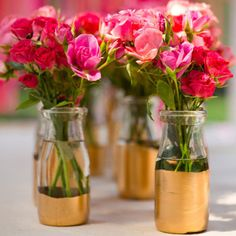 Gold dipped vases with wooden lanterns?