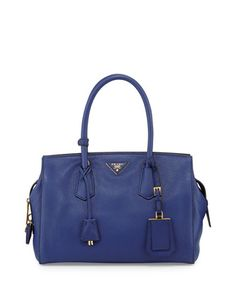 Fabulous bag, but at this price, you can buy a $1200 ticket to Milan, buy it for €600, and still come out ahead. (been there, done that.)  Vitello Grain Satchel, Ink Blue (Inchiostro) by Prada at Neiman Marcus.
