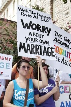 """""""With the divorce rate at 50%, worry about your own marriage""""  A National Organization for Marriage (NOM) rally in Atlanta attracted a handful of supporters and a large number of gay rights advocates who staged a silent protest. July 8, 2010. — in Atlanta, GA."""