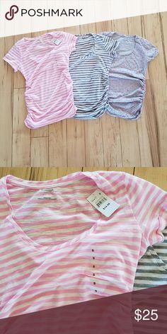 Motherhood Maternity T Shirts size Small I have 3 Motherhood  Maternity Tshirts. The pink and white one is NWT. I only wore the grey and pink dot one a couple of times. I wore the grey and white striped one several times.  All three are size small and have the side ruching to accommodate a growing baby bump! Motherhood Maternity Tops Tees - Short Sleeve