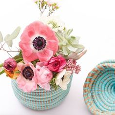 Our baskets are the perfect flower vases! {The Little Market}