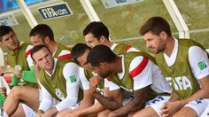 Wayne Rooney and Steven Gerrard take their seats among England's substitues ahead of the game with Costa Rica