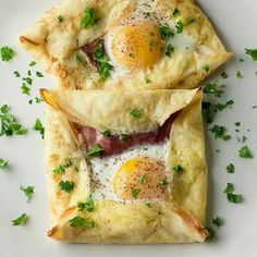 It's breakfast for dinner with these quick and easy crepes baked with ham and an egg inside!