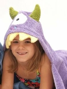 """Hooded Towel - Monster in Purple by Yikes Twins. $39.00. Theme: Monsters. Primary Color: Purple. Usually ships in 5-7 business days54"""" x 30""""Fresh from the bath or swimming, wrap your little one in the Monster Hooded Towel for kids, ideal for little boys with active imaginations! We recommend personalization in green for this special bath towel. With these fun animal hooded towels, bath time will be a cinch! No longer will your little one fight scrub a dub dub tim..."""