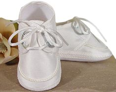 Beautifully constructed boys oxford shoe made of polyester rayon gabardine. A tiny braid accents the toe of this handsome shoe. Gabardine is a smooth, resilient, tightly-woven, lightweight, easy-care fabric. Infant Boys Sizes from Newborn to 12 Months. Christening Shoes, Baby Boy Christening, Boy Baptism, Kids Dress Shoes, Boys Shoes, New Arrival Dress, School Shoes, Crib Shoes, Bow Sneakers