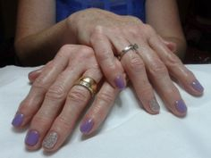 A dry manicure complete with CND Shellac 'Lilac Longing' and 'Ice Vapor' nail polish on the ring fingers.
