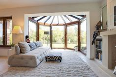 Conservatory : Eclectic style living room by Stunning Spaces Ltd