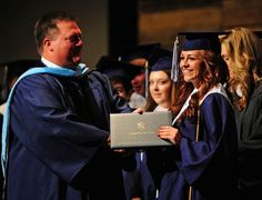 Honor graduate Destiny Fordis receives her high school diploma from Dr. David Rath during the Ascension Episcopal School commencement service in Lafayette, LA, Friday, May 24, 2013. Paul Kieu, The Advertiser