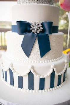 Navy Blue striped wedding cake with jewels.