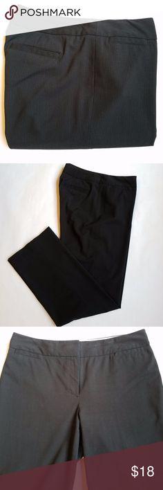 "Liz Claiborne Black Pinstripe Trouser Pants Classy Black Pinstripe pants from Liz Claiborne.  In great condition.  66% Polyester 29% Rayon 5% Spandex  16"" Waist 31.5"" Inseam 42"" Top to Bottom 10"" Rise Liz Claiborne Pants Trousers"