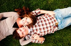 Engagement photos laying on grass looking up