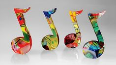 "'Dancing Music Notes' by Elizabeth Robinson Art-Glass/Sculptures ~ each is a colorful 8th note of a harmonious blend of Frit-Dichroic Glass & Gold Leaf in a Jazzy composition of kiln-formed Glass - Colors & patterns vary as no 2 are alike! Size: 4""H x 2.5""W x 0.5""D & are avail individually or as a set of four from  'artfulhome.com'♥❦♥"