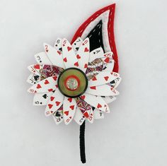 Alice in Wonderland inspired grooms corsage
