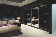 Black and glass mirrored sliding wardrobes