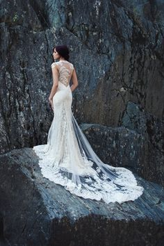 We are in love with this gown- style #Aurora - check out the beautiful back I @Miosa Couture