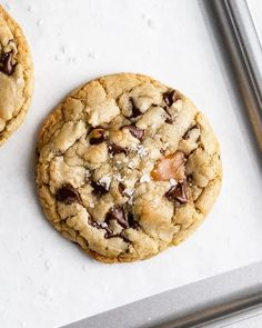 Salted Caramel Chocolate Chip Cookies For Two   Browned Butter Blondie   This chocolate chip cookie recipe is for two. A delicious small batch twist on my favorite classic chocolate cookies filled with puddles of rich, buttery caramel and pools of melted chocolate, these cookies are totally irresistible! Caramel Chocolate Chip Cookies, Frozen Chocolate, Salted Caramel Chocolate, Chocolate Caramels, Melted Chocolate, Chocolate Chips, Cookie Recipes, Desserts, Dessert Recipes