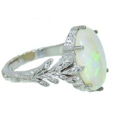 Love the band but small diamond instead of opal