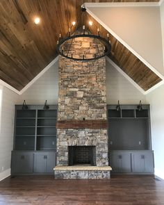 Family room fireplace flanked by built ins. Wall color (shiplap), SW Repose Gray, Cabinetry, SW Gauntlet Gray. #panelingwallsfireplace