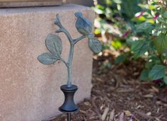 """Hose guard -- bird on brand 18"""" -- Protect that valuable plant near the corner or curve in your garden as you drag the hose across the yard with this sturdy hose guard. This cute bird will keep watch over it for you."""