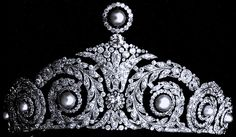 Property of the Spanish royal family.  Made by Cartier in 1920, the tiara's top pearl is removable and originally the pearls were interchangeable with emeralds.