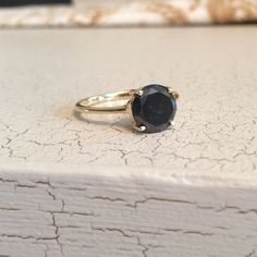 vintage ring featuring a sparkling earth-mined black diamond
