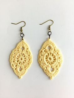 Throw on these cute crochet earrings for a casual day out on the town! These earrings are handmade by New Orleans local artist, Lady Valkryie. Measurements: 1' wide ; 2' long.