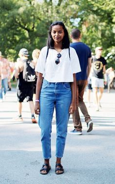 A simplistic spring look created with a simple white crop and high-waisted denim. BIRKENSTOCK