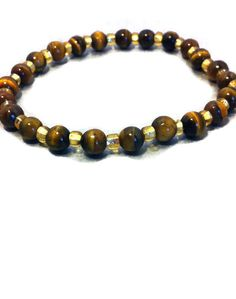 Tigereye Stretch Bracelet, With Gold Colored Spacer Beads,  Genuine Gemstone, Unisex, Handmade by AngelSentJewelry on Etsy