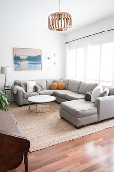 Grey sofa on jute rug look The New Berlin RAF Sectional (in custom fabric) is from Gallery Furniture. The coffee table is from Wayfair and the jute rug is from RugsUSA. Living Room Sectional, Living Room Carpet, Living Room Modern, Rugs In Living Room, Home And Living, Living Room Designs, Living Room Decor, Living Spaces, Gray Sectional