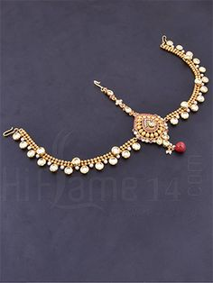 RENT : Antique Kundan Stone Maang Tikka.  Carry your style with elegancy when you match this antique maang tika decorated with kundan and pearls all over the maang tika with red bead hangings.