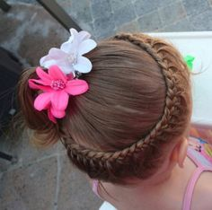 "This ring-shaped braid is fancy all on its own, but the garden-fresh accessories send it right over the top! Check out this ""around the head"" braid tutorial for ideas."