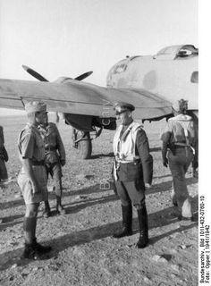 North Africa - Field Marshal Erwin Rommel (center) and fighter pilot Joachim Muencheberg (left) before bomber Heinkel He 111; Luftwaffe KBK 7 Luftwaffe.  1941 or 1942.