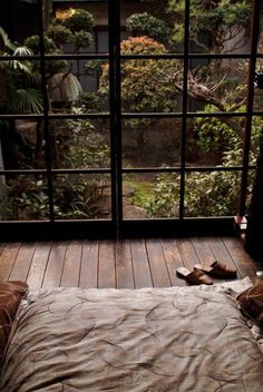 bed, large windows, garden view