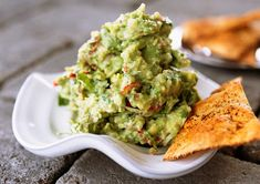 What makes guacamole taste better? Tableside preparation of course. It's crowd pleasing dish with a bit of theatrics thrown in for a great party. How To Make Guacamole, Homemade Tacos, Nachos, Fajitas, Enchiladas, Easy Meals, Appetizers, Healthy Recipes, Cilantro