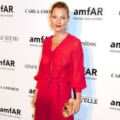 Kate Moss wears an amazing red caftan. See more celebrity style scerets here.