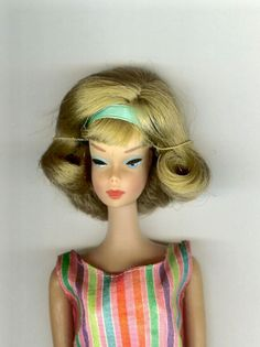 Vintage Mattel Barbie - A soft dark blonde, American Girl Barbie,  with the side part with her blue ribbon... and she is beautiful....