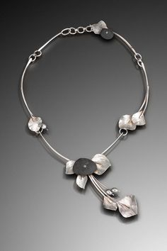 Necklace   Julie Jerman-Melka.  Lake Superior beach pebbles, hand fabricated and forged sterling silver, freshwater pearls, cold-connected champagne diamond